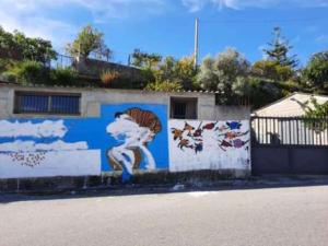 """Riace. Sfregio al murales che ricorda Impastato. Usigrai e Laganà (cda Rai): """"Trasmettere la fiction dedicata a Mimmo Lucano"""""""